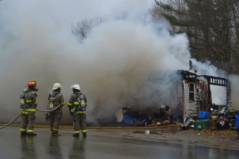 Firefighters work at the scene of a house fire on Lessner Road in Damariscotta on Thursday, April 7. (Maia Zewert photo)