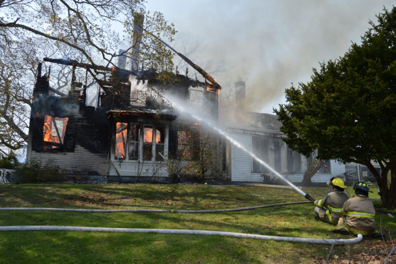 Firefighters battle a house fire at 38 South Dyer Neck Road in Newcastle on Thursday afternoon, May 12. Newcastle Fire Chief Clayton Huntley said the house was a total loss. (Maia Zewert photo)