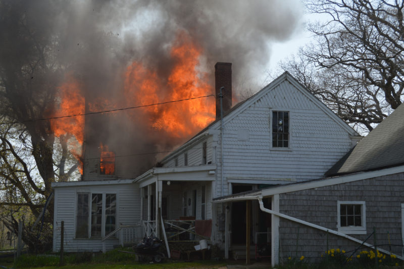 Fire tears through the roof of the house at 38 South Dyer Neck Road in Newcastle on Thursday afternoon, May 12. The cause of the fire is undetermined, according to the Maine State Fire Marshal's Office. (Maia Zewert photo)