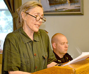 Sharon Mrozinski, proprietor of The Marston House, reads a letter signed by about 26 business owners opposing the Maine Department of Transportation's design proposals for Wiscasset village, at the Wiscasset Board of Selectmen's Tuesday, May 31 meeting. (Abigail Adams photo)