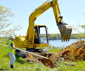 Aaron Martin (left), of Ransom Consulting, and Mike Fournier, of Environmental Projects Inc., dig a test pit on the northern portion of the Mason Station property Thursday, May 26. (Abigail Adams photo)