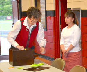 Election Clerk Joan Barnes (left) tallies results of the secret ballot vote at the Wiscasset School Department budget meeting May 25. Town Clerk Linda Perry looks on. (Abigail Adams photo)