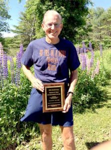 Dr. Stephen Reed, of Wiscasset, holds his 2016 United States Running Streak Association Runner of the Week plaque. On Thursday, June 16, Reed's streak of running 3 miles a day, every day, hit 40 years. (Photo courtesy Ann Hinck)