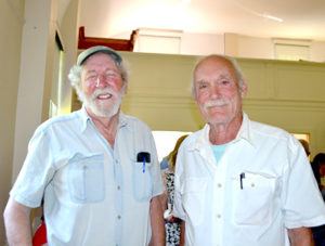 Westport Island residents approved the construction of a sand-and-salt shed at annual town meeting Saturday, June 25. E. Davies Allan (left) and William Hopkins disagreed on the issue, but discussed their differences during a break in the meeting. (Charlotte Boynton photo)