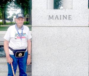 Ralph Bond, a World War II-era veteran from Jefferson, stands next to the World War II Memorial in Washington, D.C. (Photo courtesy Julie Stegna)