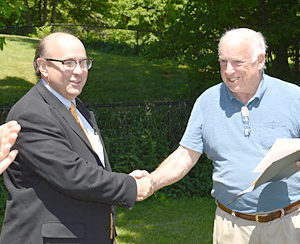 Maine Secretary of State Matthew Dunlap (left) shakes hands with Bristol Village Improvement Society President Don Means on June 22. Dunlap recognized the society for 100 years of incorporation. (Haley Bascom photo)