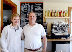 Jim Matel and his son Teddy Matel man the counter at the new Round Pond Coffee shop on Route 32 across from the Granite Hall Store in Round Pond. The shop opened Monday, June 27. (Haley Bascom photo)