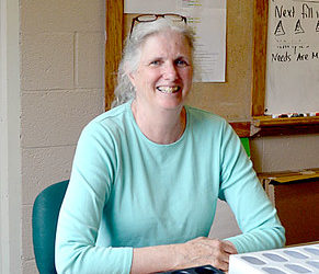 """Amy Lessner, Lincoln Academy's physical education and health teacher, will retire at the end of the school year after 42 years of teaching. Lessner's classroom used to belong to her mother, Elizabeth """"Peggy"""" Duckett, who taught English at Lincoln Academy. (Maia Zewert photo)"""
