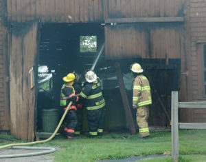 Local firefighters work at the scene of a boathouse fire on Friendship Road in Waldoboro. (Alexander Violo photo)