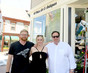 From left: manager Ryan Hinton and owners Julee and Bradbury Ketelhut stand outside 60 Main Art and Antiques in Wiscasset. (Haley Bascom photo)