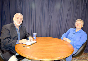 "Steve Raymond and Beth Parks prepare to tape an episode of ""Spotlight on Seniors"" at the Lincoln County Television studio in Newcastle on June 28. (Christine LaPado-Breglia photo)"