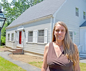 Pemaquid Watershed Association Executive Director Jennifer Hicks stands in front of the organization's headquarters in Damariscotta. (Maia Zewert photo)
