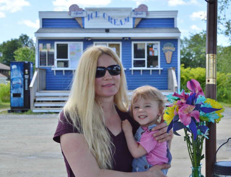 Wild Island Ice Cream co-owner and creator Summer Galvis and her daughter, Emmy, stand in front of Sarah's Scoops in Boothbay Harbor, which sells her ice cream, July 11. (Haley Bascom photo)