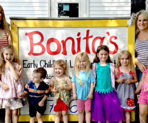 """Kristin Morgner (far left) and Kira Gallant (far right) with some of the children from the """"radishes"""" classroom at Bonita's Early Childhood Learning Center in Damariscotta. Gallant is the new owner of the business as of July 1; Morgner, the previous owner, will leave in mid-August for Pennsylvania. (J.W. Oliver photo)"""