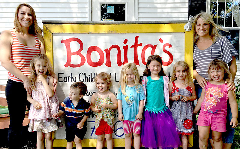 "Kristin Morgner (far left) and Kira Gallant (far right) with some of the children from the ""radishes"" classroom at Bonita's Early Childhood Learning Center in Damariscotta. Gallant is the new owner of the business as of July 1; Morgner, the previous owner, will leave in mid-August for Pennsylvania. (J.W. Oliver photo)"