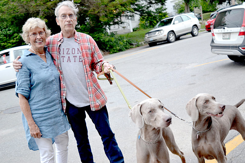 Jane Dahmen and William Wegman, with his Weimaraners Flo and Topper, outside Lincoln Theater in Damariscotta the evening of Thursday, July 14, shortly before Dahmen's live interview with Wegman as part of the theater's Talking Art in Maine: Intimate Conversations series. (Christine LaPado-Breglia photo)