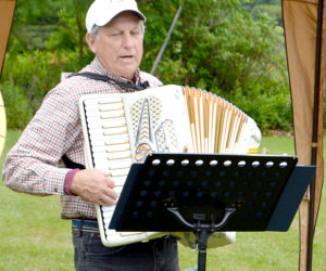 "Peter Walsh plays ""Red River Valley"" on accordion while attendees sing along. (Haley Bascom photo)"