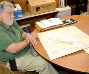 Dr. Jack Sarmanian, of Edgecomb, a Red Cross disaster mental health worker, looks over a map of West Virginia on Tuesday, July 12, following his return from a deployment to assist flood victims. (Abigail Adams photo)