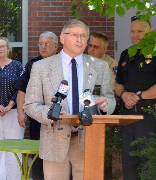 State Sen. Chris Johnson introduces the Lincoln County Recovery Collaborative, a program to connect heroin and opioid addicts to treatment resources without the threat of incarceration, during a ceremony in the courtyard of the Skidompha Public Library on Friday, July 15. (Abigail Adams photo)