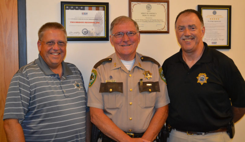 From left: Lincoln County Sheriff Todd Brackett, Oxford County Sheriff Wayne Gallant, and Sagadahoc County Sheriff Joel Merry attend a meeting of the Lincoln and Sagadahoc Multicounty Jail Authority Board of Directors on Wednesday, July 27. (Abigail Adams photo)
