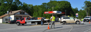 A tow truck from Hillside Collision Center prepares to remove a Toyota RAV4 from the road after a two-car accident on Route 1 in Newcastle the afternoon of Tuesday, July 5. (Maia Zewert photo)
