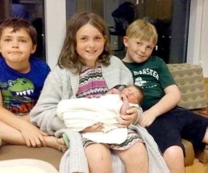From left: siblings Joseph, Emily, and Gary James Tibbetts sit with their new sister, Madeline Peaslee. The children's mother, Andrea Tibbetts, gave birth to Madeline hours after she was in a car accident on Route 1 in Newcastle the afternoon of Tuesday, July 5. (Photo courtesy Andrea Tibbetts)
