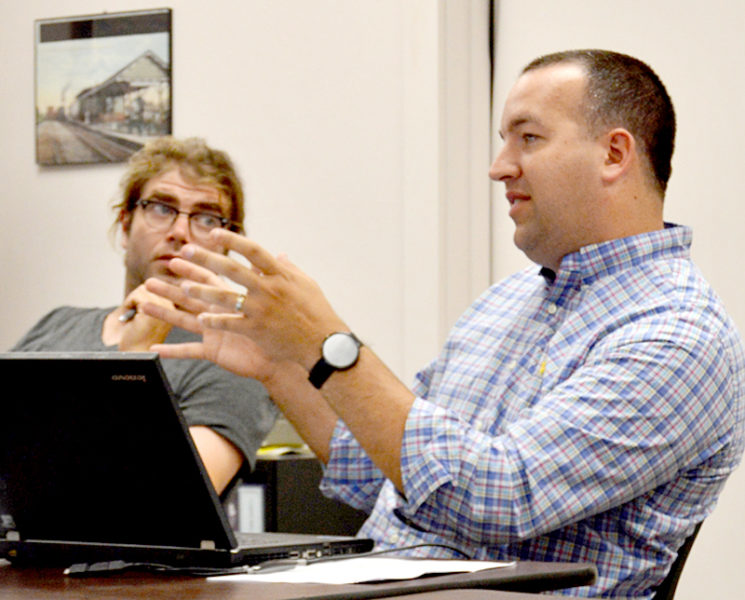 Newcastle Town Administrator Jon Duke discusses an application for street vendors during his first Newcastle Board of Selectmen meeting as town administrator Monday, July 11. Selectman Joel Lind looks on. (Haley Bascom photo)
