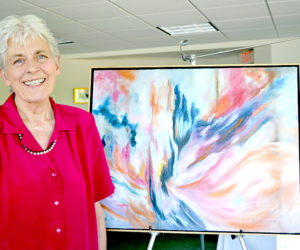 "Damariscotta artist Polly Steadman stands beside her ""wet-on-wet"" oil painting ""Phoenix"" at her recent retrospective show at The Lincoln Home in Newcastle during the Twin Villages ArtWalk. (Christine LaPado-Breglia photo)"