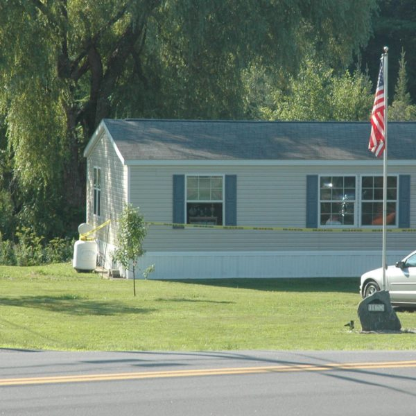 Caution tape surrounds a mobile home at the corner of Dutch Neck Road and Route 32 in Waldoboro after a kitchen fire damaged the interior of the home early Thursday, July 28. (Alexander Violo photo)