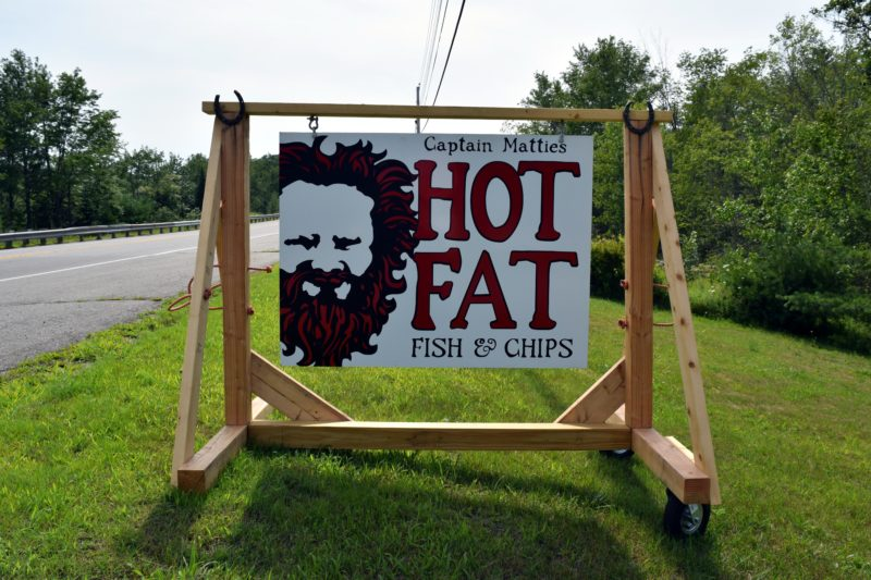 A sign alongside Route 1 in Waldoboro beckons travelers to Captain Mattie's Hot Fat Fish & Chips. (J.W. Oliver photo)