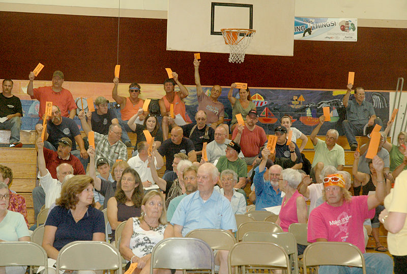 Waldoboro voters raise their cards in support of a secret ballot at a special town meeting in Waldoboro. (Alexander Violo photo)