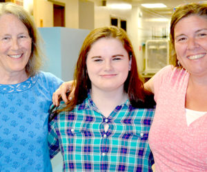 From left: Lucy Moses, Kayla Torgersen, and Kim Andersson in Wiscasset on Tuesday, July 19. Torgersen will return to the Wiscasset Middle High School as a senior on course to graduate with the class of 2017, due to the school's ACT program. (Abigail Adams photo)