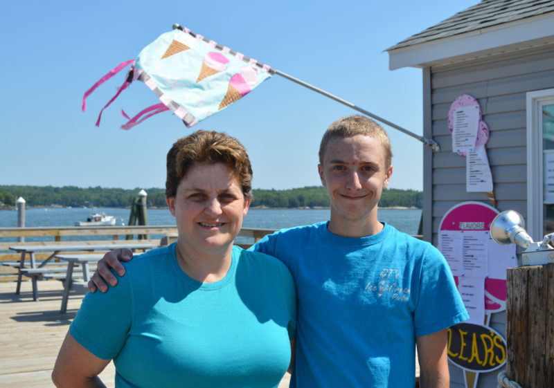 QT's Ice Cream Parlor owner Tammy Brooks and her son Keagan stand in front of the new location of QT's Ice Cream Parlor at 2 Water St. in Wiscasset on July 13. QT's opened at the new location June 3 after 10 weeks of construction and preparations. (Haley Bascom photo)