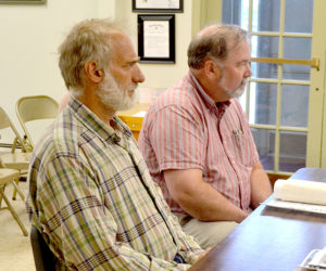 The Power Co. representative Richard Simon (left) and Coastal Enterprises Inc. representative John Egan appear before the Wiscasset Planning Board on Monday, July 11. The board approved CEI's application to install six additional solar panels at its Deer Ridge Apartments in Wiscasset. (Charlotte Boynton photo)