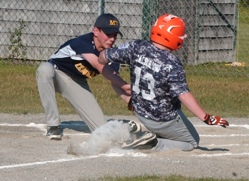 Connor Calderwood scores on a passed ball for Oceanside, as Medomak pithcer Ethan Reed applies the tag. (Carrie Reynolds photo)
