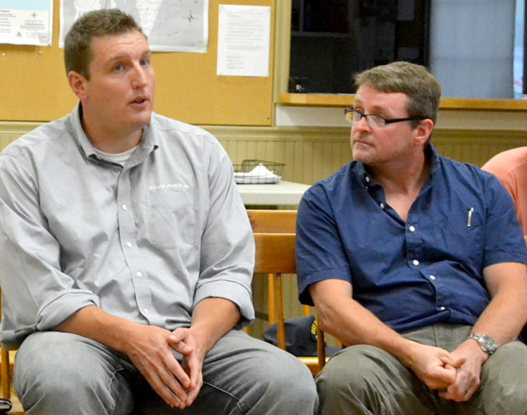 Wright-Pierce engineer Joe McLean (left) speaks during a Wednesday, Aug. 24 meeting about the Bristol Mills Dam as Bristol Fish Committee member Slade Moore looks on. (Maia Zewert photo)