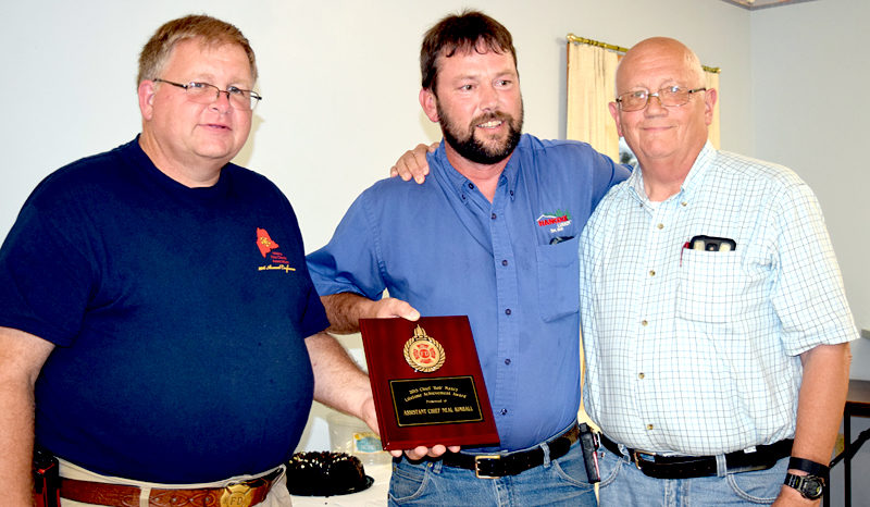 From left: Lincoln County Fire Chiefs Association Vice President Walter Morris presents the Chief Bob Maxcy Lifetime Achievement Award to former Bristol 3rd Assistant Fire Chief Neil Kimball as Bristol Fire Chief Paul Leeman Jr. looks on. (J.W. Oliver photo)