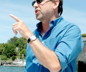 Maine Aquaculture Association Executive Director Sebastian Belle discusses the aquaculture operations on the Damariscotta River. (Alexander Violo photo)