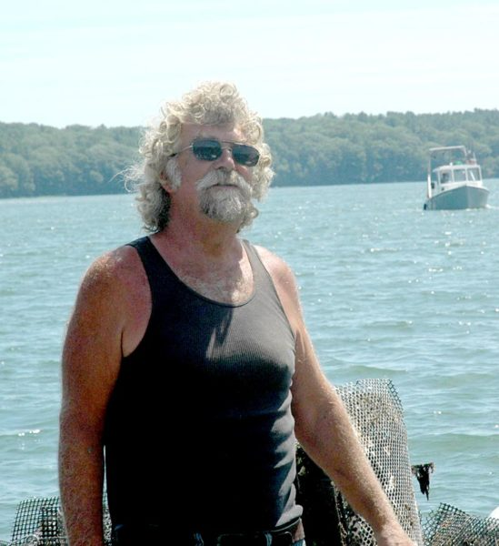 Smokey McKeen discusses the growth season for oysters in the Damariscotta River. (Alexander Violo photo)