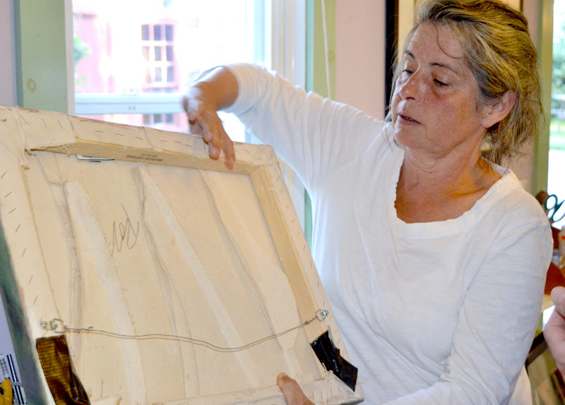 Rosalind Welsh explains her unique sewing-painting technique at Studio Roz during the Aug. 19 Damariscotta-Newcastle ArtWalk. (Christine LaPado-Breglia photo)