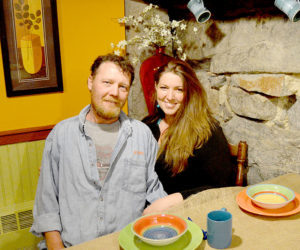 "Alex Brown and Christine Schweighauser sit at a table in Cocinas Underground in May. The ""cultural fusion"" restaurant opened Thursday, Aug. 4. (Maia Zewert photo, LCN file)"