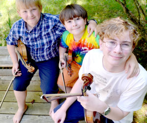 From left: Owen Kennedy, Benjamin Rosenthal, and Joshua Rosenthal make up the fiddling trio Fiddlocity². The boys competed in the East Benton Fiddlers Convention and Contest on Sunday, July 30, with Joshua winning first place, Benjamin taking second, and Owen third. (Maia Zewert photo)