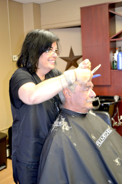 Hair ... We Are! owner and stylist Ivette Segovia cuts the hair of regular client Gerry Gifford, of Nobleboro. (Christine LaPado-Breglia photo)