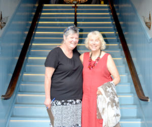 Lincoln Theater Board of Directors member Pam Gormley (left) greets Lincoln Theater member Betsy Heminway at the base of the newly renovated and reopened staircase at the venue's Theater Street entrance on the evening of Thursday, Aug. 11. (Christine LaPado-Breglia photo)