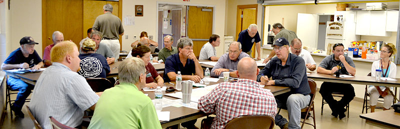 Representatives of the towns of Bremen, Bristol, Damariscotta, Newcastle, Nobleboro, and South Bristol, and of the Central Lincoln County Ambulance Service, Great Salt Bay Sanitary District, Lincoln County Emergency Management Agency, and LincolnHealth, participate in a tabletop exercise at the Damariscotta Fire Department on Thursday, Aug. 18. (Maia Zewert photo)