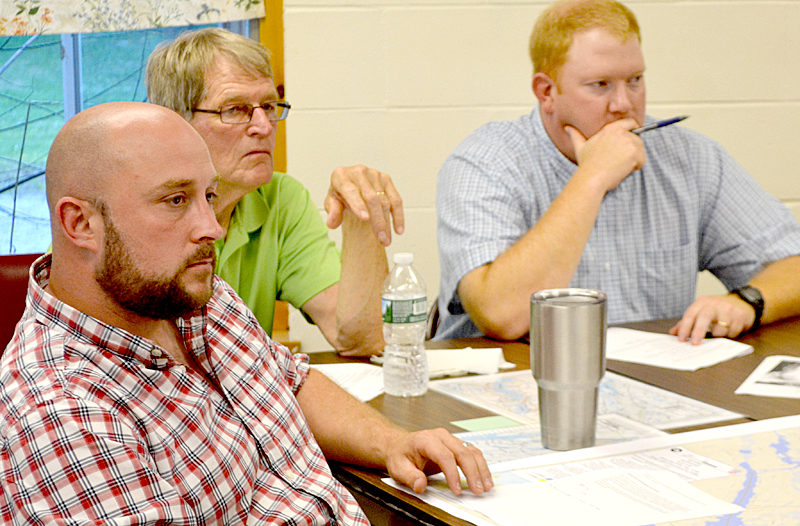 From left: Damariscotta Police Department Sgt. Jason Warlick, Damariscotta Civil Emergency Preparedness Director Steve O'Bryan, and Casey Stevens, assistant to the director of the Lincoln County Emergency Management Agency, participate in a tabletop exercise at the Damariscotta Fire Department on Thursday, Aug. 18. (Maia Zewert photo)