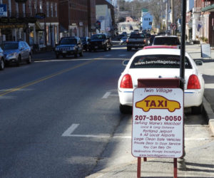 A Twin Village Taxi waits by the the curb in downtown Damariscotta. (Photo courtesy Nancy Hatch)