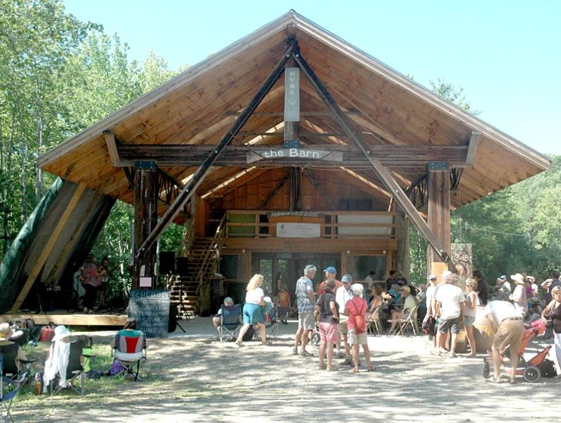 """Festivalgoers file into """"the barn"""" at Hidden Valley Nature Center at the start of the fifth annual Live Edge Music Festival. (Alexander Violo photo)"""