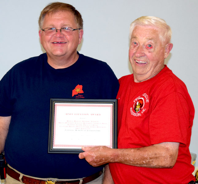 Jefferson Fire Chief and Lincoln County Fire Chiefs Association Vice President Walter Morris (left) presents a Unit Citation Award to Don Hastings, accepting on behalf of the founding members of The Jefferson Volunteer Fire Department. (J.W. Oliver photo)