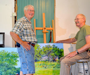 Jefferson artist John Kierstead (left) chats with Readfield artist J. Thomas R. Higgins in the barn studio Higgins occupied for the month of July as an artist-in-residence at the Joseph A. Fiore Art Center at Rolling Acres Farm in Jefferson. Kierstead, who owns one of Higgins' paintings, was in attendance at the artist studio day and open house at the art center Saturday, July 30. (Christine LaPado-Breglia photo)